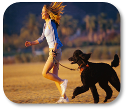 Photograph of a girl running with her dog