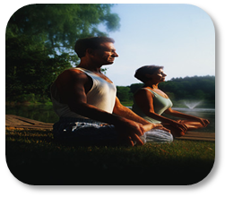 Photograph of couple practicing yoga